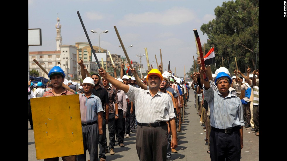 Morsy supporters march in formation in Cairo on July 2.