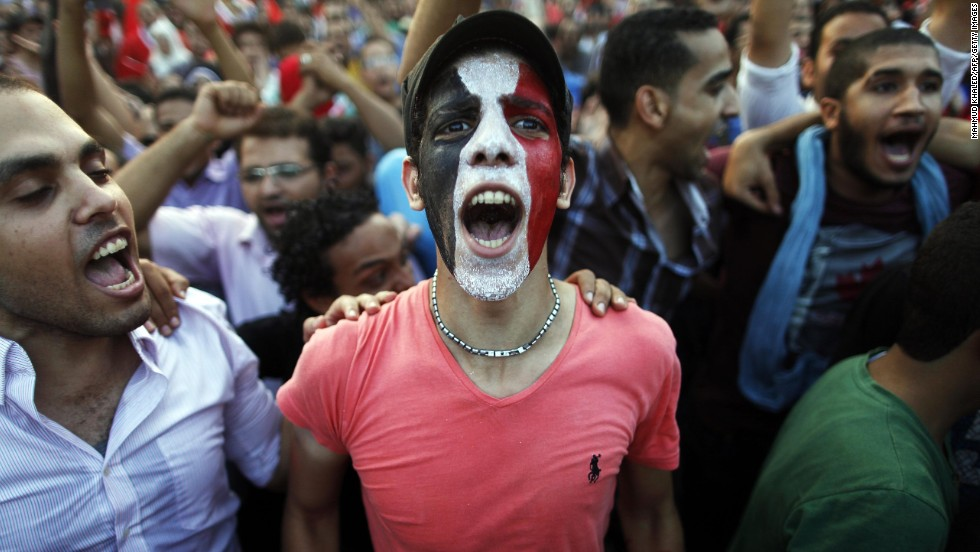Egyptians shout slogans against Morsy in Cairo on Monday, July 1.