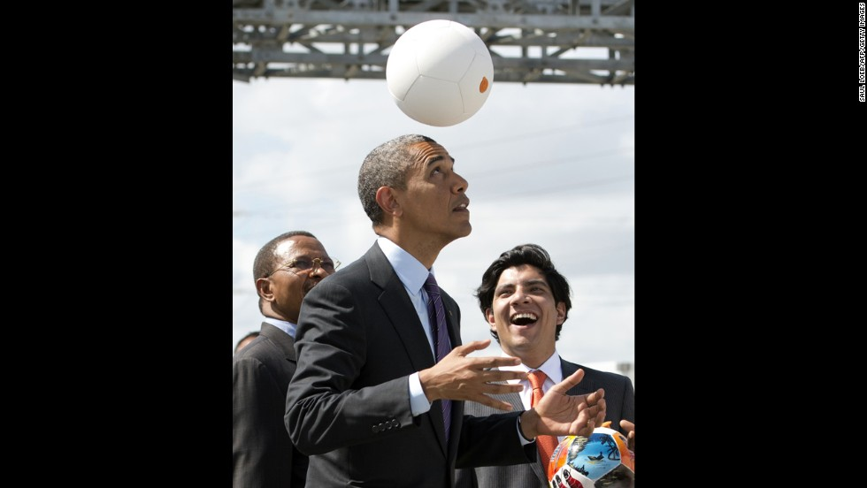 "Tanzania's president, left, watches as Obama plays with the energy-generating soccer ball at the Symbion Power Plant on July 2. ""I don't want to get too technical, but I thought it was pretty cool,"" Obama said of the ball that harnesses kinetic energy to provide power.<br />"