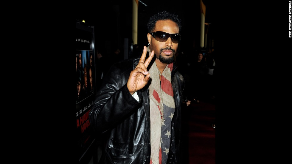 "Shawn Wayans tucks his stars and stripes around his neck for the premiere of brother Marlon Wayans' movie, ""A Haunted House,"" in Los Angeles."