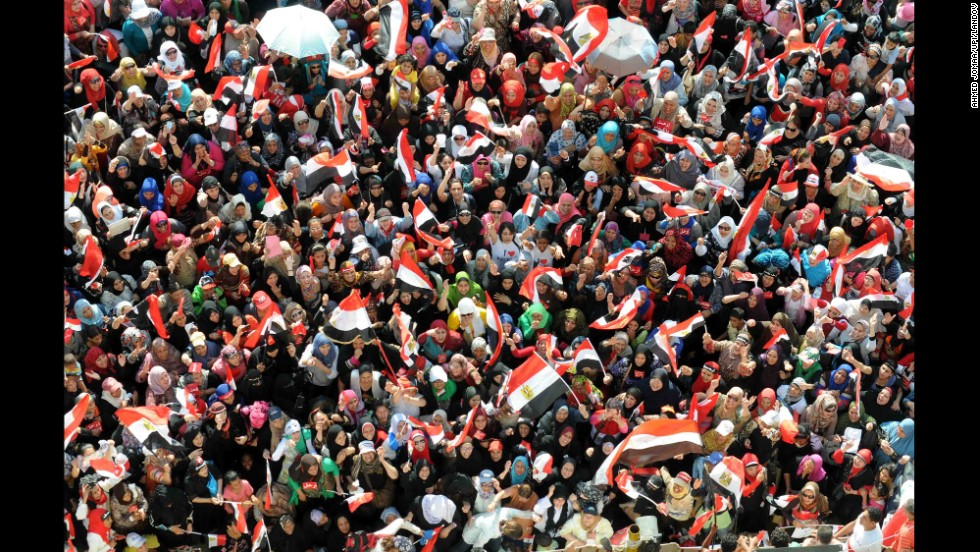 A sea of protesters opposing Morsy waves flags in Tahrir Square on Sunday, June 30. The Obama administration has urged Morsy to call early elections