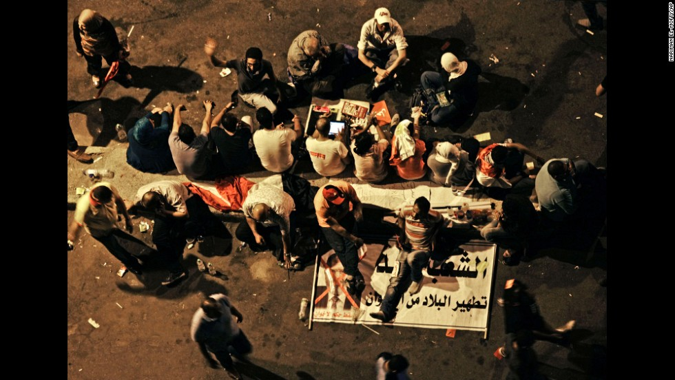 Morsy opponents sit on a banner outside the presidential palace on June 30. State-funded Egyptian daily Al-Ahram has reported 46 sexual assaults during anti-Morsy protests in Egypt since June 30.