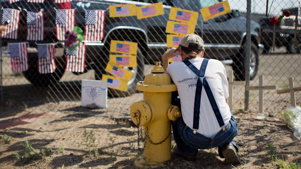Stephen Grady reads some of the notes left at the Granite Mountain Interagency Hotshot Crew fire station in Prescott on Tuesday, July 2.