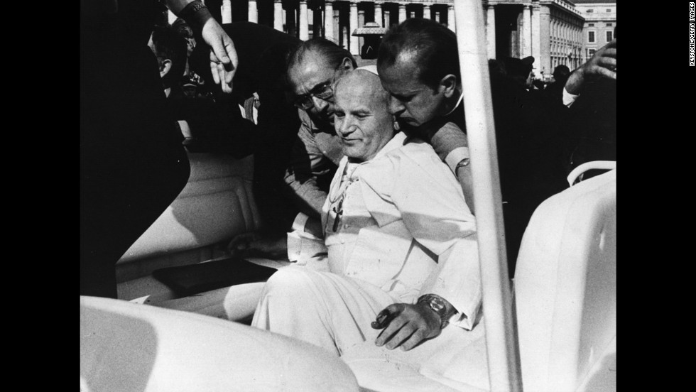 Aides help Pope John Paul II moments after a May 13, 1981, assassination attempt by Turkish gunman Mehmet Ali Agca  in St Peter's Square.