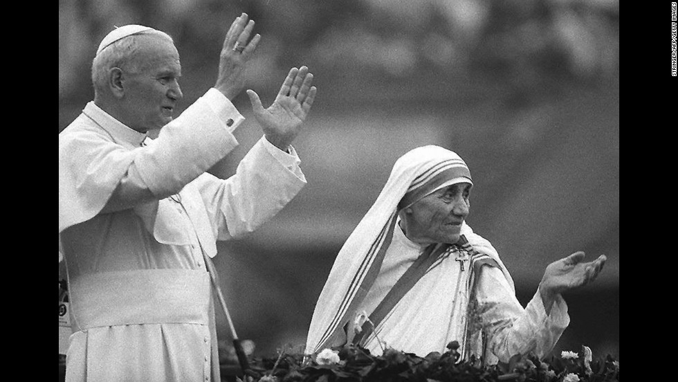 Pope John Paul II and Mother Teresa wave to well-wishers in Kolkata, India, in February 1986.