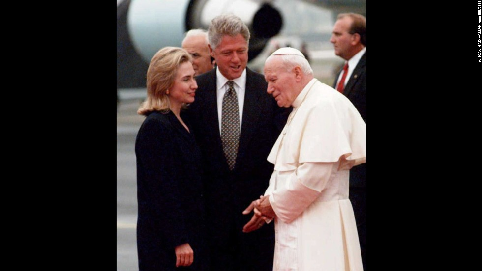 Bill and Hillary Clinton greet Pope John Paul II as he arrives in Newark, New Jersey, on a U.S. trip in October 1995.