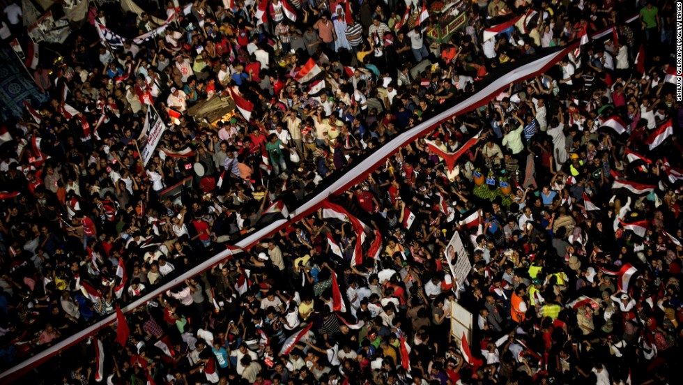 People celebrate at Tahrir Square after a broadcast on July 3 confirming that the Egyptian Army will temporarily be taking over.