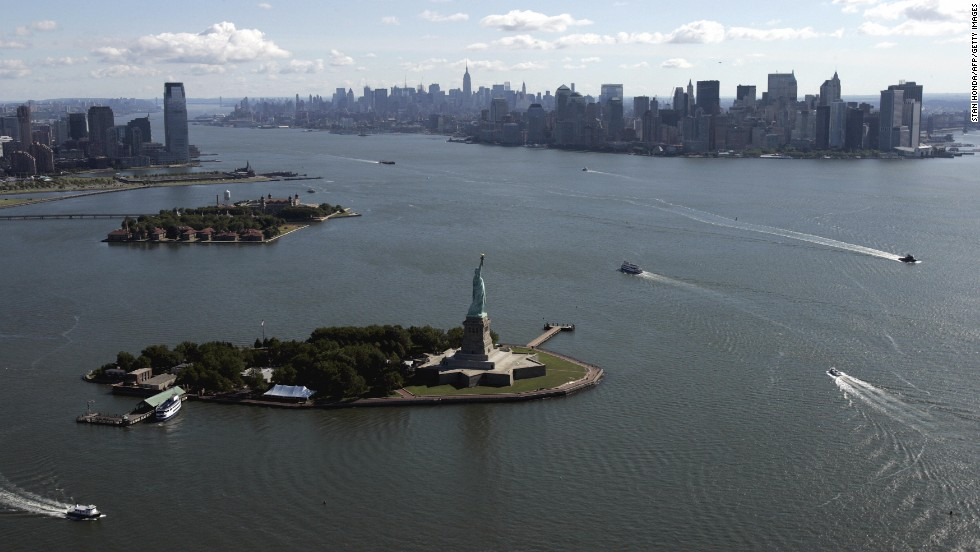 An aerial view of New York Harbor shows Lady Liberty, Ellis Island and Manhattan in 2007.