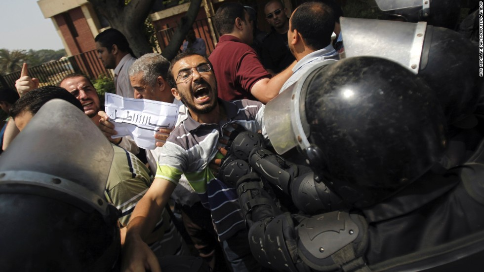 "Members of the Muslim Brotherhood and supporters of ousted Egyptian President Mohamed Morsy clash with riot police during the swearing in ceremony of  Adly Mansour as interim president in Cairo on Thursday, July 4. Egypt's military deposed Morsy, the country's first democratically elected president, the country's top general announced Wednesday. <a href=""http://www.cnn.com/2013/07/04/middleeast/gallery/egypt-after-coup/index.html"">View photos of Egypt after the coup.</a>"