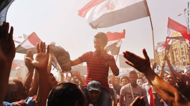 People dance and cheer at Tahrir Square in Cairo, Egypt on Thursday, July 4, the day after former Egyptian President Mohammed Morsi, the country's first democratically elected president, was ousted from power.