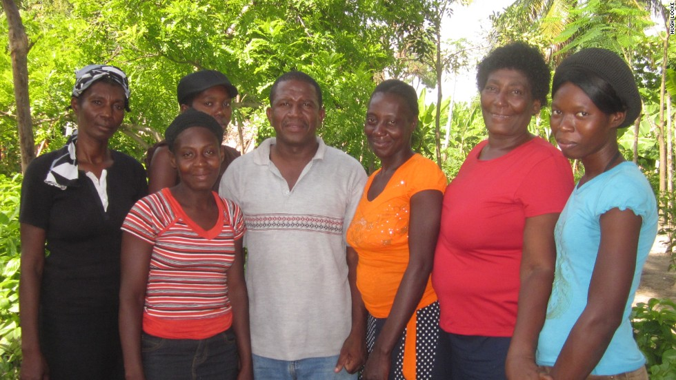 A loan from the SFA helped Haitian Romeus Mercilie (pictured second from right) to purchase new livestock and save money after hurricanes ruined her crops
