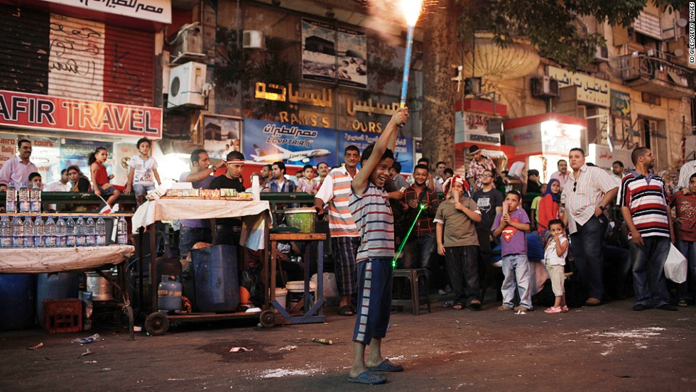 A young Egyptian boy shoots off fireworks during celebrations in Tahrir Square on July 4.
