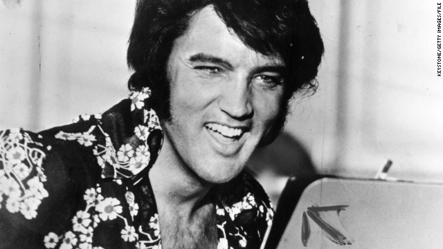"American singer and film star Elvis Presley (1935 - 1977), to his fans the undisputed ""King of Rock 'n' Roll."""