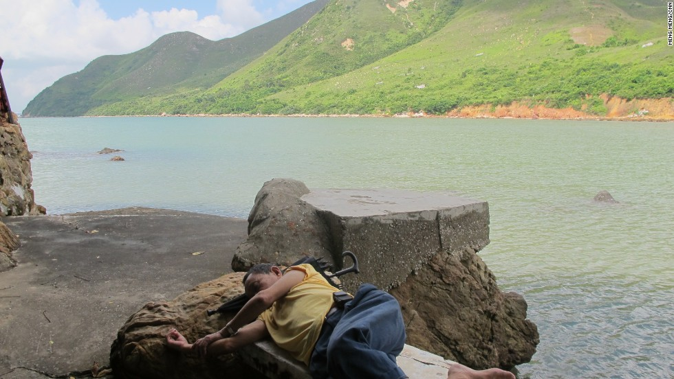 At the northeast tip of the village, a local man takes a nap.