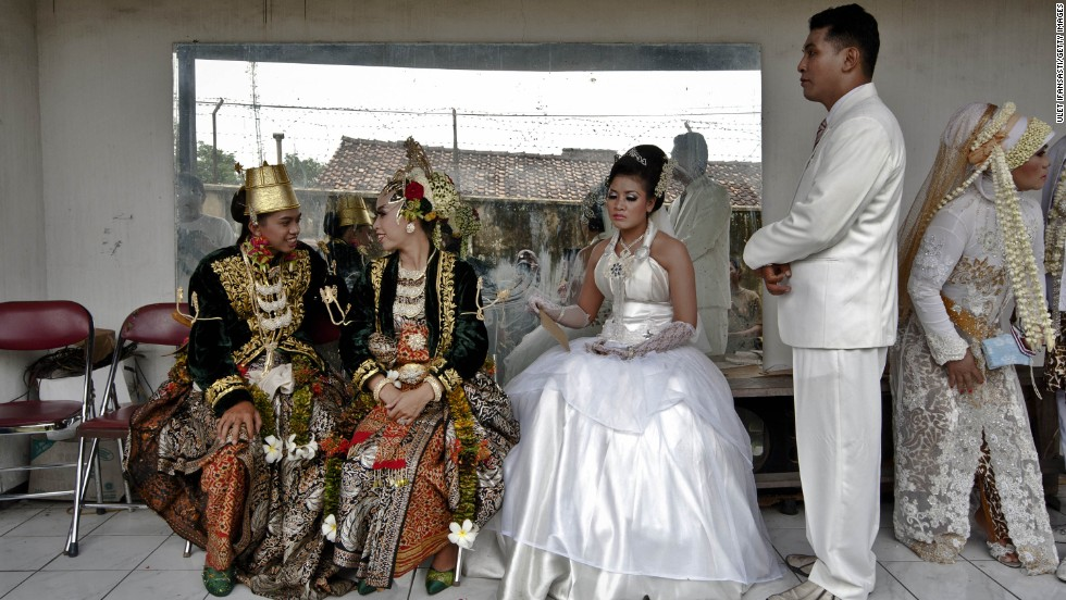 Couples prepare for marriage during a mass wedding ceremony on December 12, 2012, in Yogyakarta, Indonesia. The day saw a surge in marriage around the globe to mark 12/12/12.