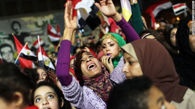 People dance and cheer in Tahrir Square, the day after former Egyptian President Mohammed Morsy, the country's first democratically elected president, was ousted from power on July 4, 2013 in Cairo, Egypt.