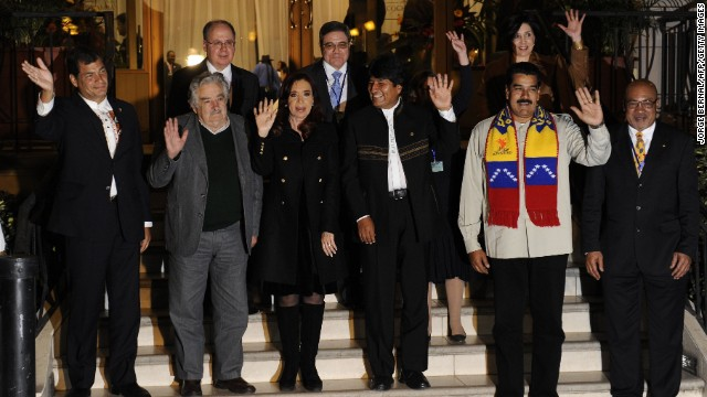 (L-R, front row) Presidents Rafael Correa of Ecuador, Jose Mujica of Uruguay, Cristina Fernandez de Kirchner of Argentina, Evo Morales of Bolivia, Nicolas Maduro of Venezuela and Desi Bouterse of Suriname pose for pictures after a meeting called after Evo Morales' plane was rerouted amid suspicions US fugitive Edward Snowden was aboard, in the Bolivian central city of Cochabamba, on July 4, 2013. Leftist Latin American leaders gathered in Cochabamba on Thursday to back President Evo Morales, fuming after some European nations temporarily refused his plane access to their airspace amid suspicions US fugitive Edward Snowden was aboard. Snowden is seeking sanctuary in several nations to evade US espionage charges.