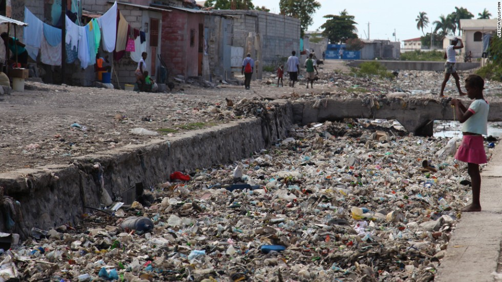 Imagine living with this on your doorstep. Residents of Haiti's Cite Soleil slum endure shockingly bad sanitation with garbage clogging the district's sewer canals.