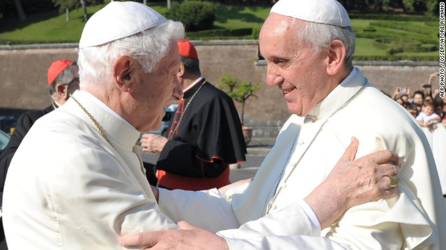 This handout picture released by the Vatican press office on July 5, 2013 shows Pope Francis (R) greeting Pope Emeritus Benedict XVI during the inauguration of the Statue of St. Michele in the Vatican gardens.