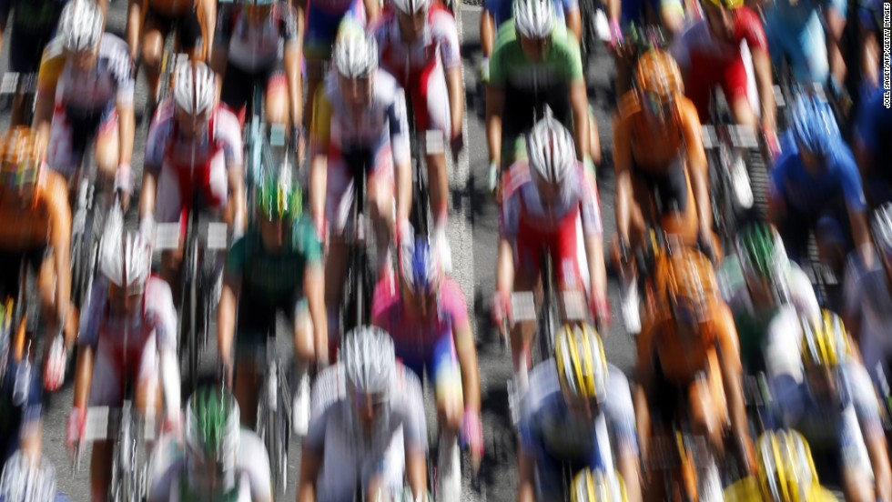 "JULY 5 - MONTPELIER AND ALBI, FRANCE: The pack rides during the 205.5 km seventh stage of the <a href=""http://cnn.com/2013/06/28/worldsport/gallery/tour-de-france-in-pics"">100th edition of the Tour de France </a>cycling race on July 5 between Montpellier and Albi, southwestern France. <a href=""http://cnn.com/2013/07/04/sport/cycling-tour-impey-greipel-cavendish/?hpt=hp_bn2"">Daryl Impey </a>became the first South African to don the famous yellow jersey as Andre Greipel powered to his first stage win."