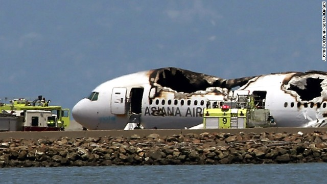 The Boeing 777 airplane lies burned on the runway after it crashed landed on July 6.