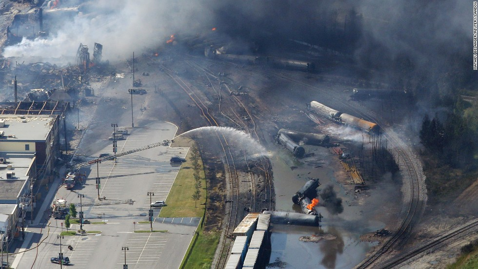 Firefighters work to put out fires at the wreckage of the train in Lac-Megantic on July 6.