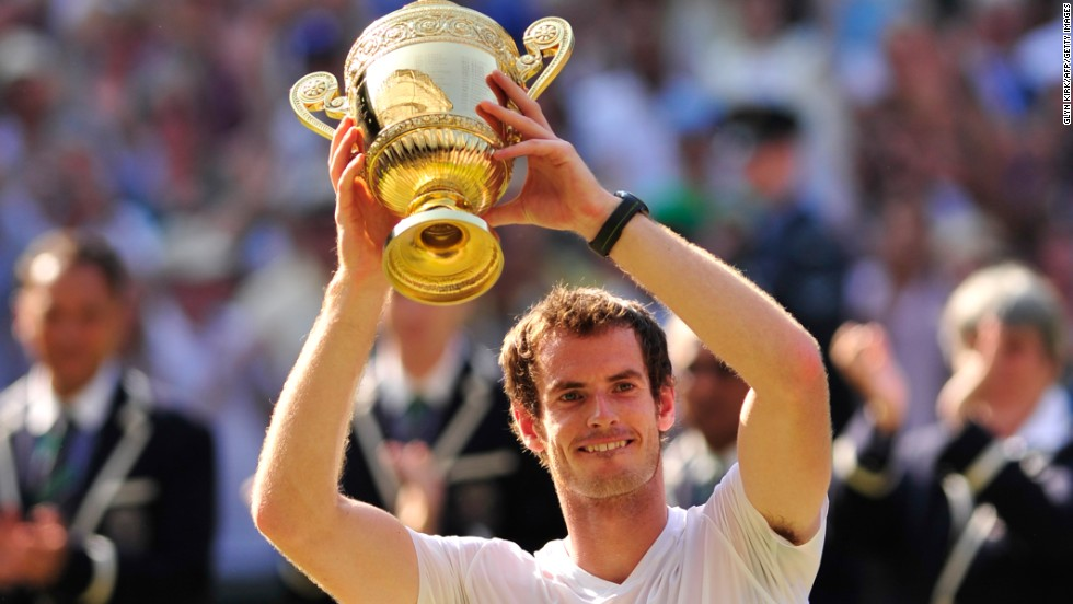 Andy Murray lifts the Wimbledon trophy to become the first British man to win the title since Fred Perry in 1936 following a straight sets win over Novak Djokovic.