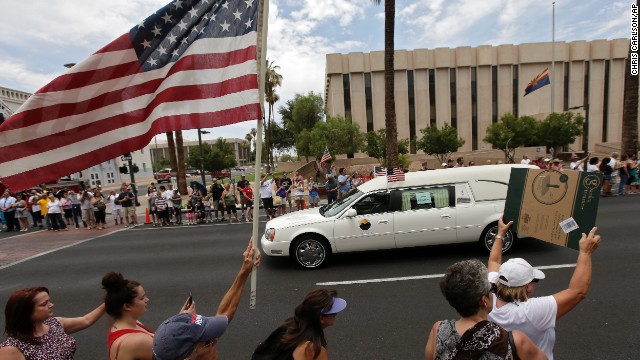 The bodies of 19 firefighters who died in the Yarnell Hill Fire are transported through Phoenix on July 7.