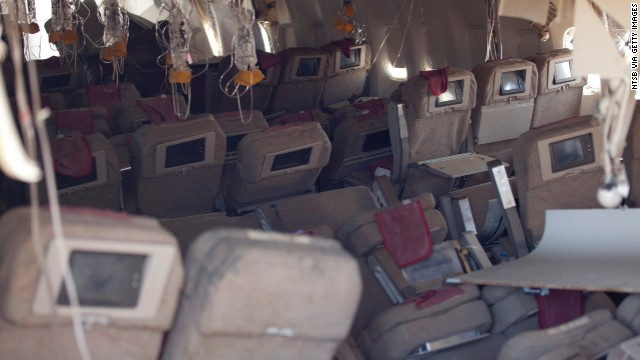 In this handout photo provided by the National Transportation Safety Board, oxygen masks hang from the ceiling in the cabin interior of Asiana Airlines flight 214 following yesterday's crash, on July 7, 2013 in San Francisco, California. The Boeing 777 passenger aircraft from Asiana Airlines coming from Seoul, South Korea crashed landed on the runway at San Francisco International Airport. Two people died and dozens were injured in the crash. (Photo by NTSB via Getty Images)