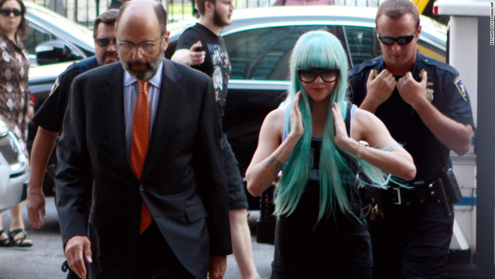 "Bynes and attorney Gerald Shargel arrive for a court appearance in New York on July 9, 2013. She was charged with reckless endangerment and attempting to tamper with physical evidence. <a href=""http://miami.cbslocal.com/2014/06/30/amanda-bynes-new-york-bong-tossing-case-dismissed/"" target=""_blank"">The case was later dismissed. </a>"