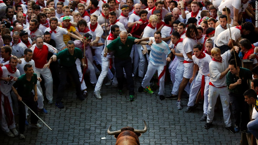 Participants back away from a bull on July 7.