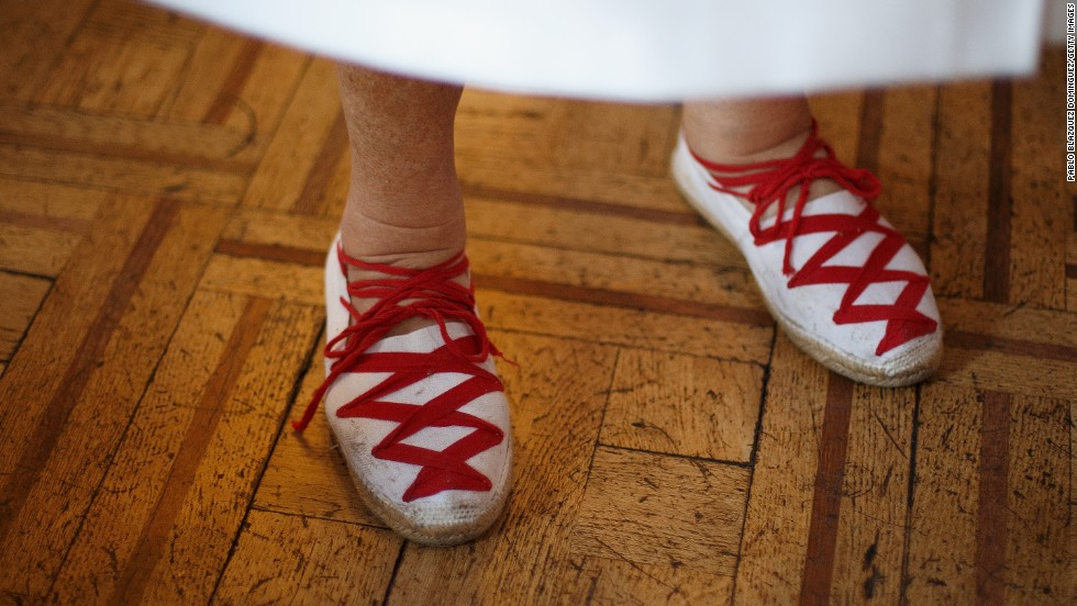A woman wears a pair of red-laced espadrilles during El Baile de la Alpargata, a dance at the Casino Principal Club, in Pamplona on July 10.