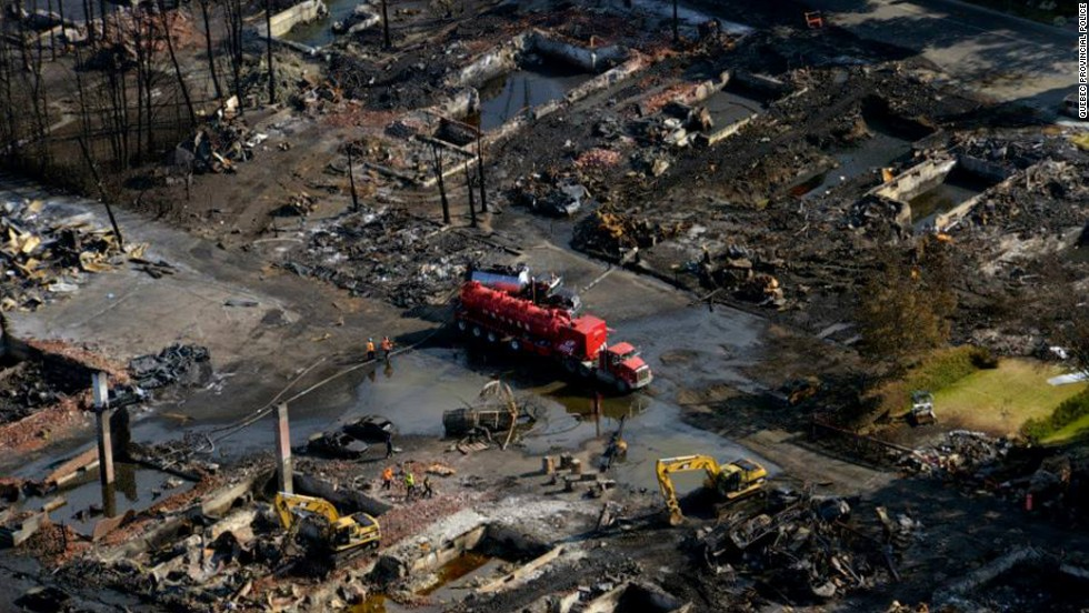 Firefighting vehicles from the United States helped Canadian authorities battle the blaze in Lac-Megantic, a town of about 6,000 people 130 miles east of Montreal.