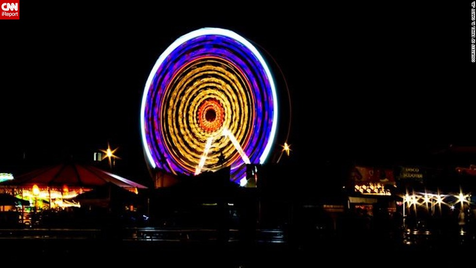 "Technical Sergeant Ernel R. Carty Jr. of the United States Air Force captured the light of the spinning Ferris wheel at the Fourth of July celebrations at the <a href=""http://ireport.cnn.com/docs/DOC-1001619"" target=""_blank"">Ramstein Air Base in Germany</a>. ""It was spectacular for a multitude of reasons. To begin, it was a military celebration that opened with the German and American National Anthems. Just the opening itself set the stage for what my family and I thought were one of the most patriotic and spectacular firework displays that we have ever had the pleasure to see. The display lasted for at least 30 minutes of non-stop fireworks,"" said the 31-year-old  who is originally from Belle Glade, Florida."