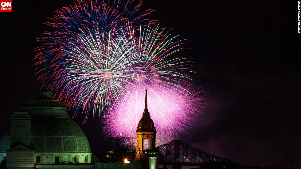"This beautifully composed photo of the Montreal skyline was taken by Mark Connor from the rooftop of a friend's apartment block during the <a href=""http://ireport.cnn.com/docs/DOC-996683"" target=""_blank"">annual Montreal fireworks competitions</a>. The photo shows the Jacques Cartier Bridge, the Old Palace de Justice and the old Town Hall."