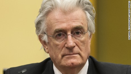 Bosnian Serb wartime leader Radovan Karadzic appears in the courtroom for his appeal judgement at the International Criminal Tribunal for Former Yugoslavia (ICTY) in The Hague, The Netherlands, on July 11 2013. AFP PHOTO/ POOL/MICHAEL KOOREN (Photo credit should read MICHAEL KOOREN/AFP/Getty Images)