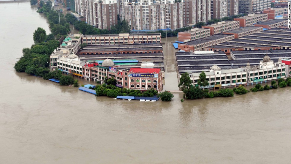 The Tuo River floods Jintang county on Thursday, July 11.