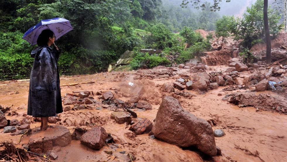 A woman looks on in the aftermath of the landslide in Dujiangyan on July 10.