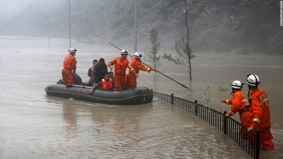 Rescuers search for victims as deep floodwaters sweep through Beichuan on July 9.