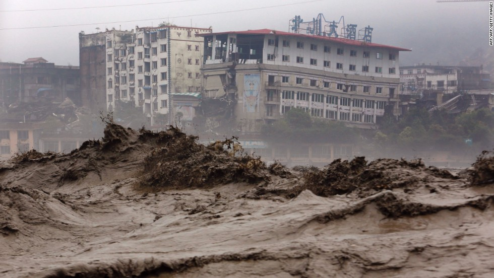 Heavy floods sweep through Beichuan County in southwest China's Sichuan province on Tuesday, July 9.