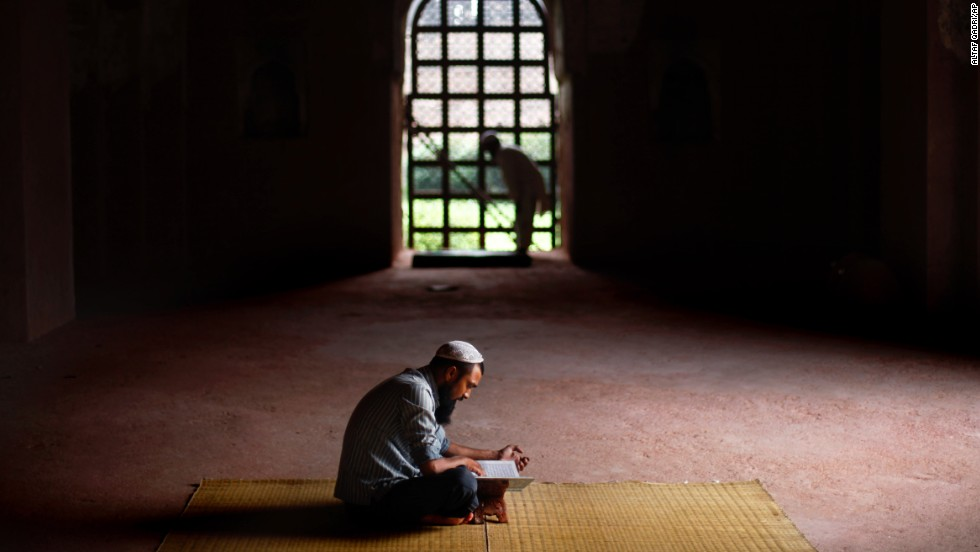 A man reads the Quran at an old Mughal-era mosque in New Delhi on July 12.