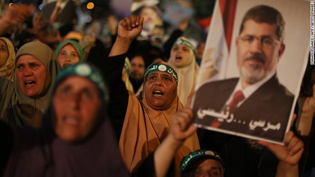 Egyptian supporters of the Muslim Brotherhood shout slogans in favour of Egypt's deposed president Mohamed Morsy (portrait) after breaking the fast outside Cairo's Rabaa al-Adawiya mosque on July 10, 2013, the first day of Islam's holy month of Ramadan.
