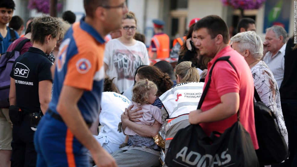 Injured passengers wait to receive medical treatment on July 12 at the Bretigny-sur-Orge station, where the train derailed.