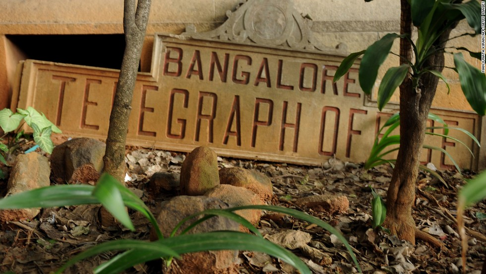 A derelict name board for the Bangalore Telegraph office lies on the ground outside the premises in Bangalore, India, on June 13, 2013. On July 15, 2013, the Indian government will discontinue the 162-year-old service.