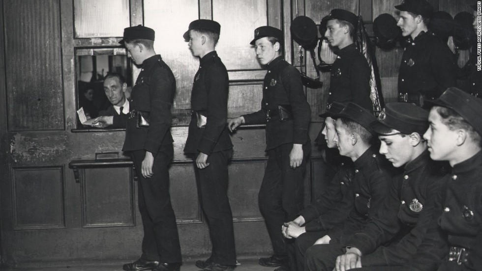 Telegraph boys line up to receive telegrams for delivery at the Central Telegraph Office in London, where 50,000,000 telegrams were processed every year. The telegram service stopped operating in the UK in 1982.