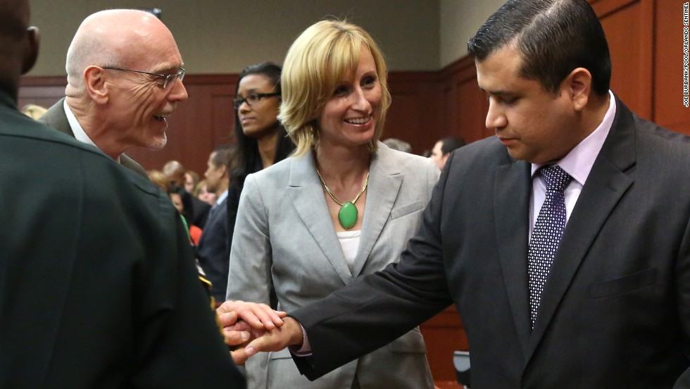 "George Zimmerman is congratulated by members of his defense team, Don West and Lorna Truett, after the not guilty verdict is read on Saturday, July 13, in Sanford, Florida. A jury of six women found him  not guilty in the shooting death of Trayvon Martin. <a href=""http://www.cnn.com/2013/07/13/justice/gallery/zimmerman-trial-reaction/index.html"" target=""_blank"">View photos of the public reaction to the verdict.</a>"