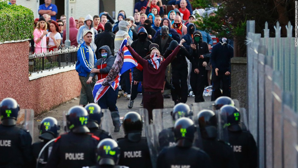 Northern Irish loyalists clash with police in Belfast, Northern Ireland, on Saturday, July 13, a day after protests broke out because a Protestant Orange Order parade was blocked from marching past the predominantly Catholic and nationalist Ardoyne area.