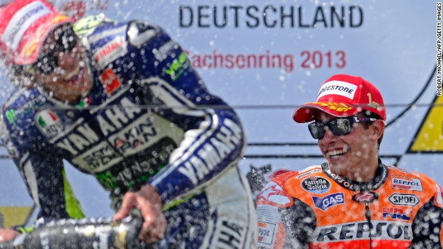 Marc Marquez, right, won the German Grand Prix to take the lead in the MotoGP standings.