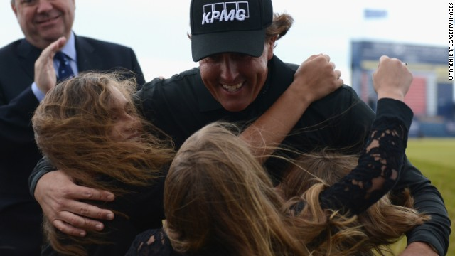 Phil Mickelson hugs his three children after winning the Scottish Open in a playoff at Castle Stuart.