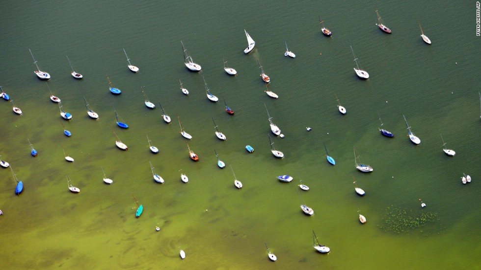 Sailboats dot Lake Ammersee, near Herrsching, in southern Germany on Saturday, July 13.